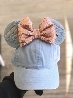 Hat is adjustable to fit most sizes lightweight. Ears are flat. The ripped jean is handmade so they all vary.