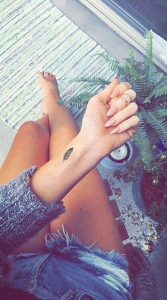 Small Indian Feather Wrist Black Henna Tattoo Ideas for Women at MyBodiArt.com on front shoulder