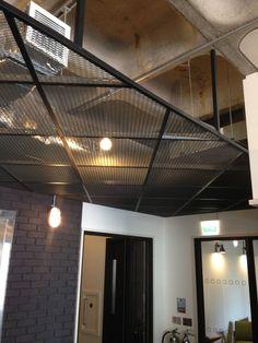Suspended mesh ceiling, Love this look very nice textures plus industrial feel || Modern Ceiling | Office Ceiling | Interior Design || #ModernCeiling #OfficeCeiling www.ironageoffice.com