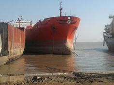 Tankers waiting to be dismantled at the Alang shipbreaking yard in India. The industry has turned what was a jungle paradise into a hell of spilled oil and chemicals and broken ship parts, ghettos of workers and their families who live in shacks.