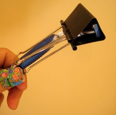 when travelling, place a binder clip over the end of your razor to avoid cuts