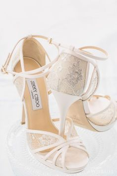 photo: ARTIESE Studios via Wedluxe; tasteful lace jimmy choo wedding shoes;