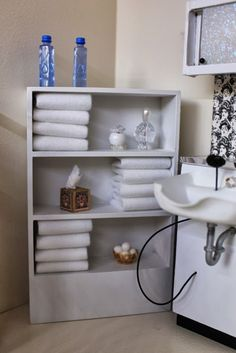 And the shelves are fully stoked with crisp, white towels.  Copyright: The Little Dollhouse Company