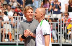 Jim Courier and Andre Agassi play an exhibition match.  2011 Roland Garros.  #tennis