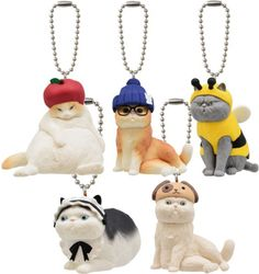 BUNEKO Gashapon: This series of capsule toys features cats in many different outfits, from a bee costume to a maid's dress and even a 'dog hat.'