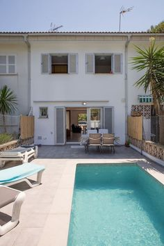 Back terrace with private pool, outdoor dining area and solarium.