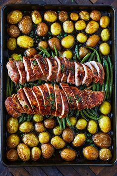 Sheet pan pork tenderloin with new potatoes, green beans & herb butter This is the Best Pork Tenderloin Recipe I have ever had! It is packed full of amazing flavor and makes for such an easy weeknight dinner!