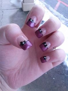 Purple french tips with bow and cute jewel