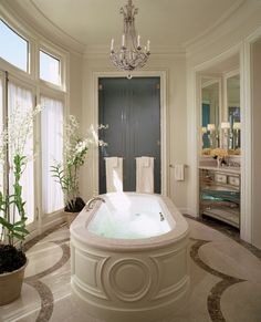 Love the panel molding around the tub. I would like this look above my living room window with a bullseye mirror.