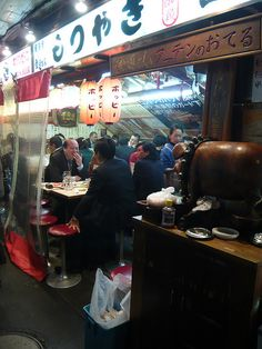 Top 50 Things To Do In Tokyo. Yakitori Alley Yurakucho There are a lot of corporate offices in Yurakucho, which has helped many small after work bars open nearby. Under the JR overpass, there are many bars to visit. Many customers frequent the same place daily giving these bars a friendly atmosphere. You can order just one stick of yakitori if you're on a budget and drink prices are quite cheap. This is a good place to go for a cheap dinner and to meet Japanese people.