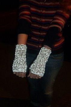 I walk home on a few dark, busy roads and reflective mitts seemed like a good idea. I've shortened the pattern a bit to save on reflective yarn disappearing up my coat sleeves, and modified the th. Bike Sketch, E Textiles, Crochet Yarn, Diy For Kids, Fingerless Gloves, Crocheting, Knitted Hats, Needlework, Kids Outfits