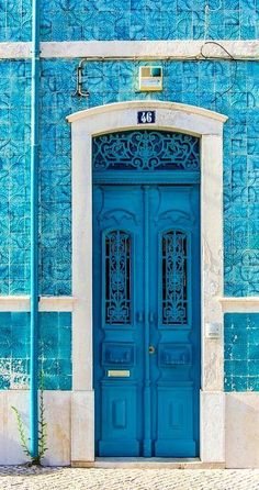 blue door on blue tiled wall