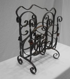 Nice heavy sturdy wrought iron magazine holder. Has 3 decorative metal star on each side. One front section needs to be spot welded in two areas,one area is held together by wire. Also the top handle has bent down on one side. Some rust, nothing major. Metal is strong, not like the newer stuff. 16 1/2 in tall 13 1/4 at widest 4 3/4 in deep at holder area bottom is 7 1/2 in deep INTERNATIONAL SHIPPING IS NOT FREE - need your postal code to calculate cost  Check out my handmade clothing at…