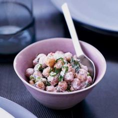 Indian-Spiced Chickpea Salad with Yogurt and Herbs | Chef Jerry Traunfeld, who traveled through India last year, flavors this creamy chickpea salad with aromatic herbs and Indian spices, among them mustard, cumin and fennel seeds.