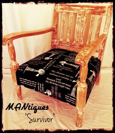 """""""Survivor""""  Antique Oak arm chair with a South African flavor.  Rustic oak frame polished to highlight its character and seat covered in black and white windmill & Afrikaans expressions fabric."""