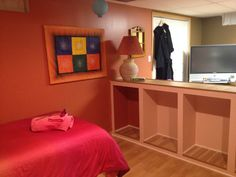 """Part of the """"Crazy Canuck"""" room.  Storage, and leading into the home entertainment center and home gym."""