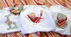Super cute onesies made by cutting fabric with the Cricut!