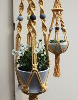 Love these Macramé plant holders by Jesse Tucker