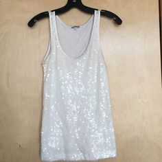 Express Sparkly White Tank Top Perfect for a night out or cute daytime wear as well! Scoop neck tank lightly used- body is 60% cotton 40% Modal; outs hell decoration is 100% polyester Express Tops Tank Tops