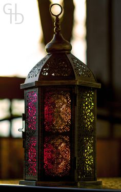 Day 151 - Afternoon Spectrum Playing around with my friend's Moroccan lantern in the late afternoon light. This decorative piece has three cutout sides and three coloured glass sides in pink, green. Moroccan Lighting, Moroccan Lamp, Moroccan Lanterns, Moroccan Design, Moroccan Style, Lantern Lamp, Candle Lanterns, Light Of Life, Love And Light