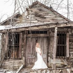 Rustic bridal portrait in the snow at an old house in Tennessee. Image by JoPhoto.