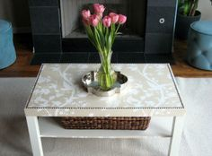 Like this idea - do up an old table easily with wall paper or heavy duty wrapping paper