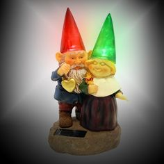 Gnomes holding hearts and flower with Solar Powered Light Garden Statue Yard Art Outdoor Patio - Outdoor Figurine Lights - Amazon.com