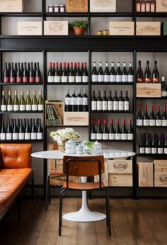 Love this gorgeous and sleek wine room and storage