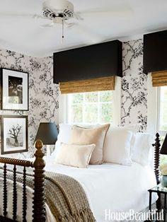 Black valances + black bed frame bring a room together...