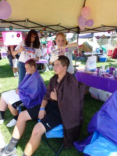 2012 RFL Team Fundraiser, Crazy Purple Hair booth. This was a huge success!