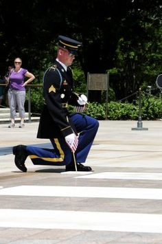 "Sgt. Christopher Anthony, Sentinel, Tomb of the Unknown Soldier, 3d U.S. Infantry Regiment (The Old Guard), places a flag at the Tomb of the Unknown Soldier, Arlington National Cemetery, Va., May 24, 2012. The ceremony known as ""Flags In"" is performed to commemorate and honor U.S. military personnel ahead of the upcoming Memorial Day weekend and has been conducted annually since 1948. (U.S. Army Photo by Sgt. Jose A. Torres Jr.)"