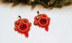 Christmas earrings, Red Yellow gold earrings, Soutache earrings, Elegant Medium Earrings, Soutache Jewelry, Christmas gift, Ethnic earrings Beautiful Red, Yellow, Orange and gold Earrings suitable for the Christmas Night. They can be also a beautiful gift for somebody special or a new jewelry for your new dress ... This earrings are made in soutache embroidery technique. The color is combination of red, yellow, orange and gold. They are made with Rayon Soutache, Glass Beads, Acrylic Beads… Soutache Earrings, Gold Earrings, Christmas Night, Christmas Gifts, Christmas Earrings, Acrylic Beads, Embroidery Techniques, Orange, Yellow