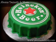 "Heineken Cake - 10"" Orange cake with Dulce de Leche filling, soaked with Special Pampero Oro Venezuelan Rum syrup and covered with fondant! All details and letters were made by hand on fondant.:"