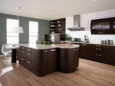 Great white grey and brown kitchen with brown cabinet big countertop metallic chimney wall shelves and lights