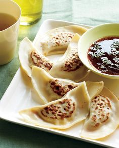 """Shrimp Pot Stickers with a Sriracha-Ginger Dipping Sauce:  Ok while out on my quest to find whole wheat won ton wrappers, a had a conversation with a chef at Whole Foods who suggested if we were going to have """"pot sticker night"""" tonight, why not make some shrimp ones as well for a little variety?   Challenge Accepted!"""