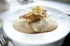 Pan-roasted local tilefish is served with smashed red potatoes with truffles, braised leeks and a wild-mushroom emulsion at The Lake House restaurant in Bay Shore.