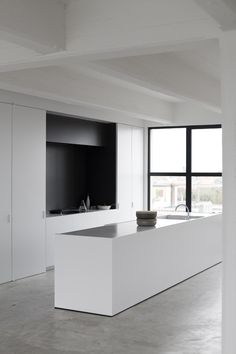 WHITE minimalist kitchen with CONCRETE floor
