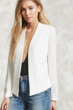 A woven blazer featuring an open front, padded shoulders, long sleeves, and mock front pockets.