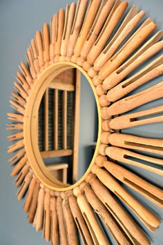 Learn how to make a starburst mirror with vintage clothespins! Great for a laundry room!