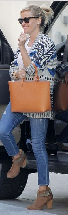 Reese Witherspoon's tan handbag, brown boots, and sunglasses street style id