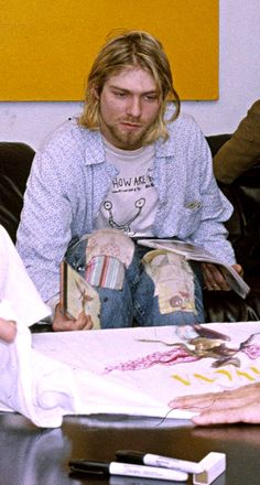 Kurt Cobain checking new 'In Utero' T-shirts in New York, NY, US. September 24, 1993