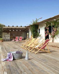 A wicker pergola provides shade and a deck adjoins a large covered patio with a concrete floor. Vinyl Pergola, Wood Pergola, Cheap Pergola, Backyard Pergola, Pergola Plans, Pergola Kits, Pergola Ideas, Steel Pergola, Pergola Swing