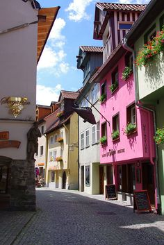 Streets of Lindau (Bayern) Germany - Storied Lindau occupies an island in Bodensee near the Austrian and Swiss borders. While a bustling modern town is connected via roadway, the city center retains its medieval core and charm.