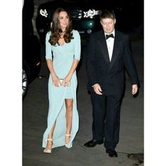 First photo of Kate arriving at National History Museum in a Jenny Packham gown, The Duchess of Cambridge attends the Wildlife Photographer of The Year Awards Stunning powder blue wrap dress split to the waist but with a modesty skirt underneath She's also wearing cream satin evening shoes with a tie around the ankle and a silver filigree necklace. #DuchessOfCambridge #arrives #NHMLondon #duchessCatherine #dress #JennyPackham #stunning #WPY2014 Source www.twitter.com/HuffPostUKPics.
