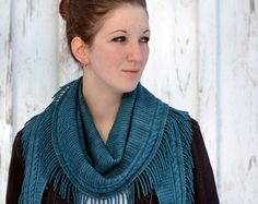 "Shawl Knitting Pattern PDF: The Artifact Shawlette is inspired by the ancient ruins, fossils and relics that record our history and the passage of time. A spider web lace edging reflects how our past and future are intertwined, while both Egyptian and Celtic influences are evident in the ""woven"" borders and central scroll motif on this lovely crescent shaped shawl. The Artifact Shawl knitting pattern is worked from the bottom up using a US 6 (or size needed to obtain gauge) 32"" (81 cm)…"