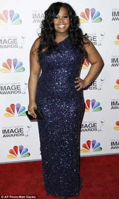 Amber Riley. Generally I don't like sequins/glitter but the colour of this dress makes up for it.