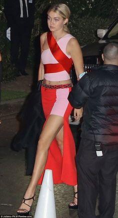 Gigi Hadid wearing Versace Asymmetrical Silk Cady Skirt and Versace Banded Silk Cady Crop Top