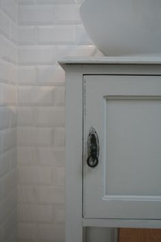Bathroom sink cupboard, painted in Farrow and Ball Purbeck Stone.