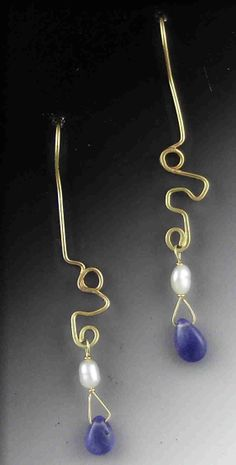 Freeform 14K yellow gold wire earrings.  Free moving Tanzanite briolette bead as a dangle topped off with beautifull fresh water Pearls.