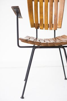 designer: Arthur Umanoff Manufacturer: Raymor Period and Model: Mid-Century Modern Specs: Wood, iron These Arthur Umanoff arm chairs for Raymor are in very good vintage condition. Available here: http://theswankyabode.com/collections/seating/products/arthur-umanoff-arm-chairs-for-raymor-01181612